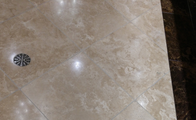 Barona Restroom Travertine Drain After